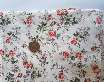 Cream poly-cotton fabric remnant with orange/red/green rose print