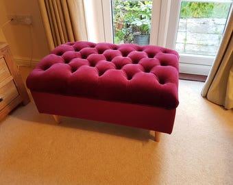 Deep buttoned tall footstool in velvet