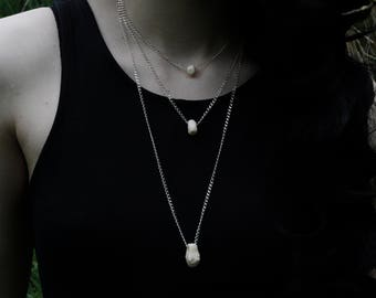 Elegant minimalistic necklace with bonecharm