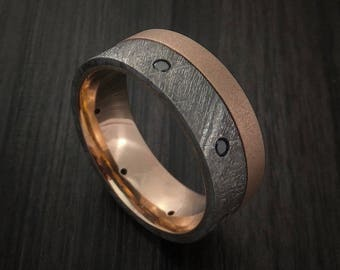 Gibeon meteorite and rose gold band with black diamonds