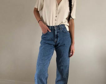 80s Levi's 554 High Waisted Faded Denim Jeans | 28W 2/4