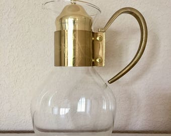 Vintage gold coffee carafe with flower detail