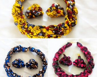 Sets of colourful and bright blue, yellow and pink african prints braided necklaces and earrings