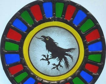 Unique vibrant heraldic crow painted and stained glass circular panel ready to hang
