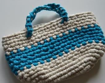 Blue and white striped crochet handbag