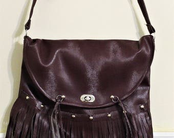 Reddish brown fringed faux leather bag