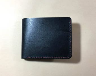 Veg tanned leather wallet with manual locking system