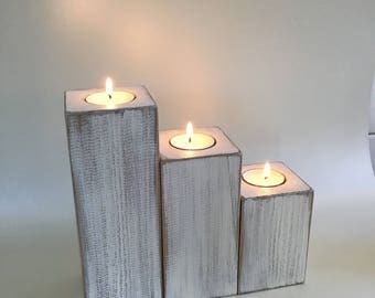 Wooden whitewashed candle holders, tea lights,beach house,pillar candles.