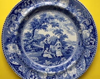 A Set of Four Antique Blue and White Dinner Plates