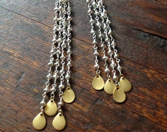Brass raindrop earrings on silver pyrite strands of rosary chain.