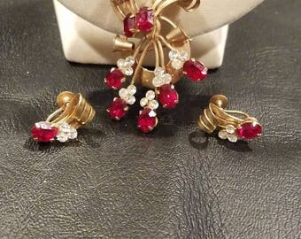 Vargas pendant and clip earrings. Ruby and gold