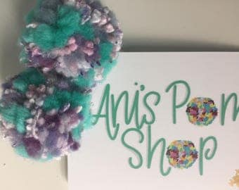 Purple and turquoise pom pom clips