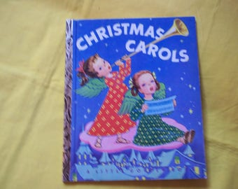 Christmas Carols arranged by Marjorie Wyckoff, pictures by Corinne Malvern