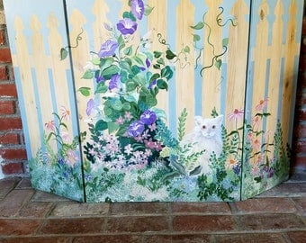 cat and flowers hand painted fire place screen.