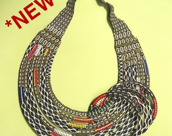 SALE 30%! Gorgeous set of black African women. Necklace Choker type bib with 7 strips and 4 bracelets.