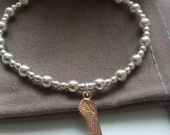 beaded sterling silver stacking bracelet with angel wing charm