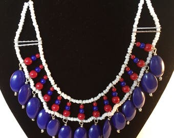 Vintage blue, white and red bead necklace with dangle fringe and silver tone chain