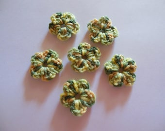 Yarn color is green/yellow crochet flowers