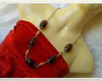 necklace brown transparent beads and small orange beads