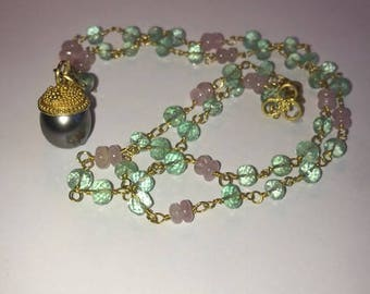 Faceted emerald and pink sapphire necklace.