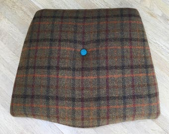 Recycled seat pads covered using traditional materials such as using Harris Tweed