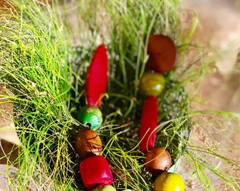 Red green and brown wooden beaded necklace.