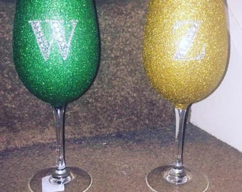 Glitter wine or champagne glasses. We also glittered plastic martini glasses for a family holiday