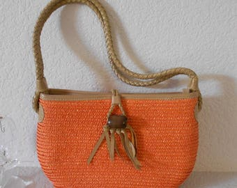 Donna Dixon women's orange straw  bag with braided handles