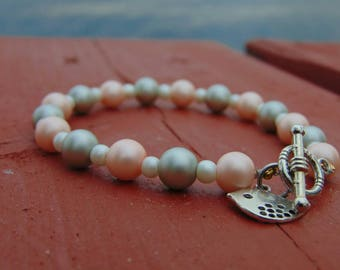 Beautiful and simple pearl beaded bracelet with bird charm