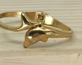 Vintage Gold tone unsigned hinged Dolphin Bracelet with rhinestone eyes very good vintage condition