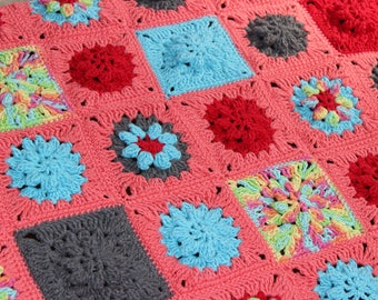 Colorful crochet blanket with granny square flower stich
