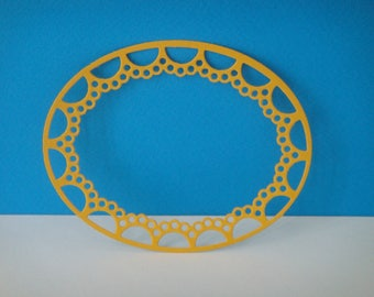 Cut oval frame with ornaments dark yellow for creation