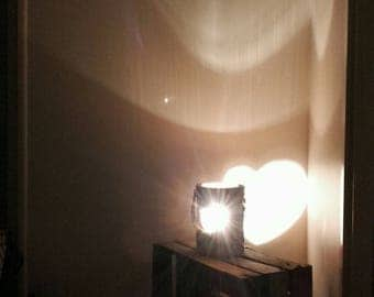 Mood lamp with a heart on the wall projection