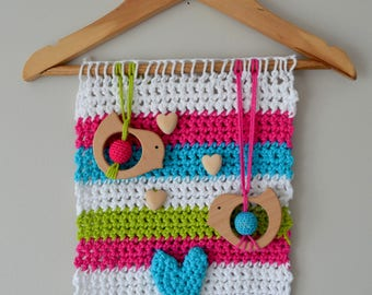 Hanging/tapestry/baby mobile is hand crocheted with 2 birds and a heart on a wood hanger