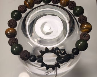 """Handmade and unique men/women bracelet with gear closure mount on a waxed linen cord 8"""""""