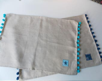 Linen placemats trimmed with tassels