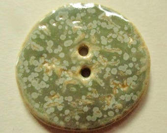 1 green button flecked grey porcelain