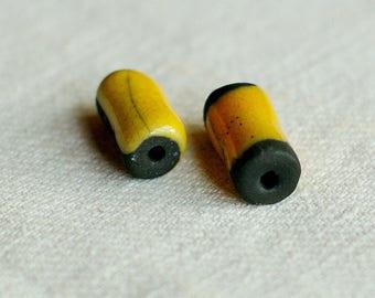Set of 2 beads yellow and black raku pottery
