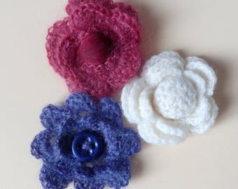 3 large flowers are hand crochet