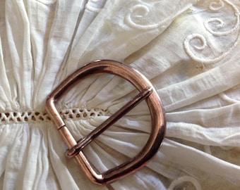 Small vintage brass belt buckle