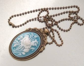 Necklace: Picture with white flowers on sky blue