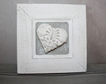Cute frame in plaster and its fragrant heart