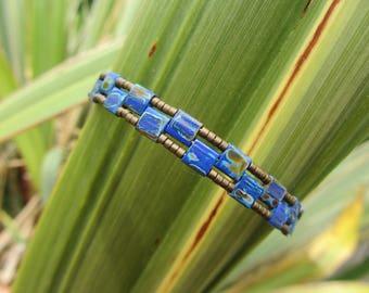 rigid boho woven bracelet with delicate Miyuki Tila and Miyuki glass beads, blue Sapphire and bronze