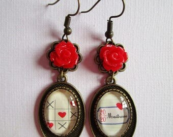 """Mistress 20/20"", hanging earrings, bronze"