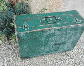 weathered wooden suitcase