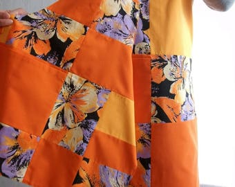 Orange, purple and black patchwork aprons