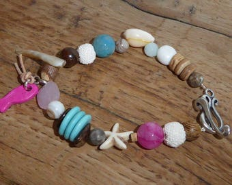 Bracelet pink fish and shells