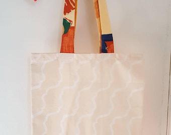 """The """"Orla"""" tote bag cream swirl with multicoloured strap"""