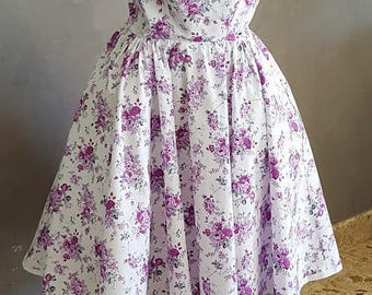 VINTAGE DRESS HAS FLOWERS. HAND MADE