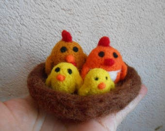 Little chicks and their nest of felted wool.